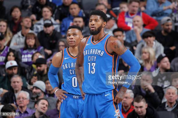 Russell Westbrook and Paul George of the Oklahoma City Thunder face the Sacramento Kings on February 22 2018 at Golden 1 Center in Sacramento...