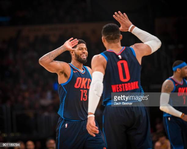 Russell Westbrook and Paul George of the Oklahoma City Thunder high five during the game against the Los Angeles Lakers at the Staples Center in Los...