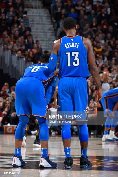 Russell Westbrook and Paul George of the Oklahoma City Thunder look on during the game against the Cleveland Cavaliers on January 20 2018 at Quicken...
