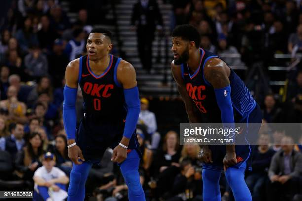 Russell Westbrook and Paul George of the Oklahoma City Thunder look on during the game against the Golden State Warriors at ORACLE Arena on February...