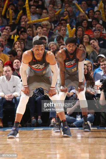 Russell Westbrook and Paul George of the Oklahoma City Thunder look on during the game against the LA Clippers on March 16 2018 at Chesapeake Energy...