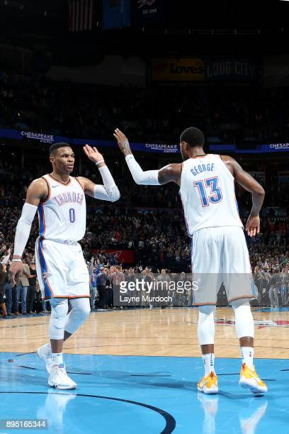 Russell Westbrook and Paul George of the Oklahoma City Thunder react after winning against the Denver Nuggets on December 18 2017 at Chesapeake...