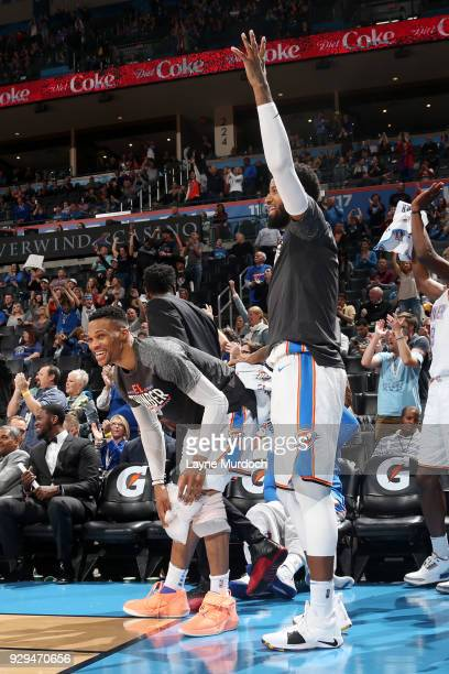 Russell Westbrook and Paul George of the Oklahoma City Thunder react during the game against the Phoenix Suns on March 8 2018 at Chesapeake Energy...