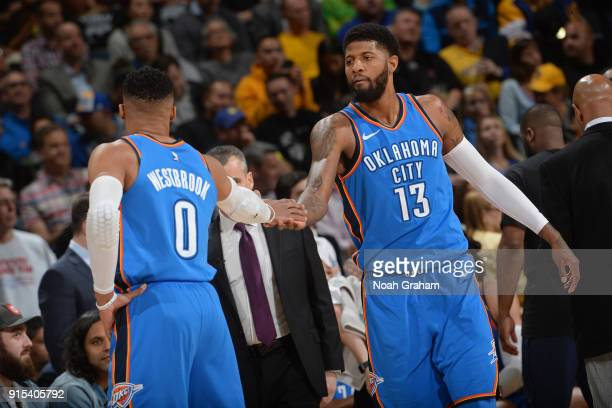 Russell Westbrook and Paul George of the Oklahoma City Thunder shake hands during the game against the Golden State Warriors on February 6 2018 at...