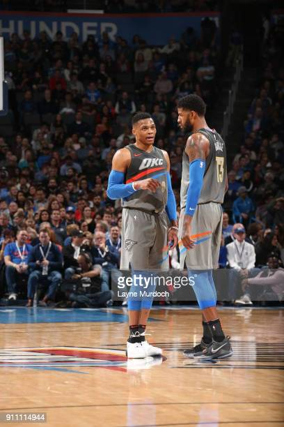 Russell Westbrook and Paul George of the Oklahoma City Thunder talk during the game against the Washington Wizards on January 25 2018 at Chesapeake...