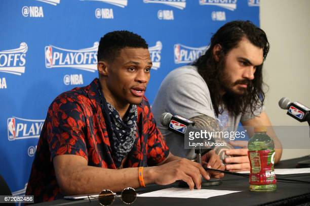 Russell Westbrook and Steven Adams of the Oklahoma City Thunder talk with the press after the game against the Houston Rockets in Game Four during...