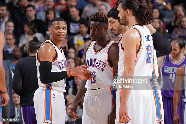 Russell Westbrook Anthony Morrow Enes Kanter and Steven Adams of the Oklahoma City Thunder huddle up during the game against the Sacramento Kings on...