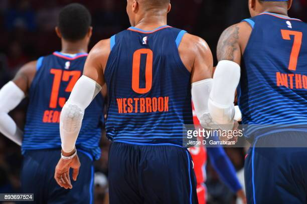 Russell Westbrook Carmelo Anthony and Paul George of the Oklahoma City Thunder look on against the Philadelphia 76ers at Wells Fargo Center on...