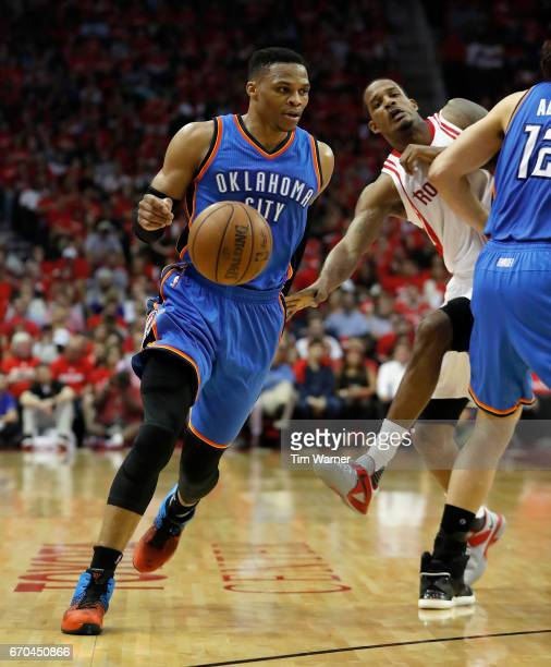 Russell Westbrook drives toward the basket defended by Trevor Ariza of the Houston Rockets during Game Two of the Western Conference quarterfinals...