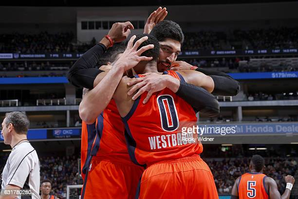 Russell Westbrook Enes Kanter Steven Adams of the Oklahoma City Thunder hug during the game against the Sacramento Kings on January 15 2017 at Golden...
