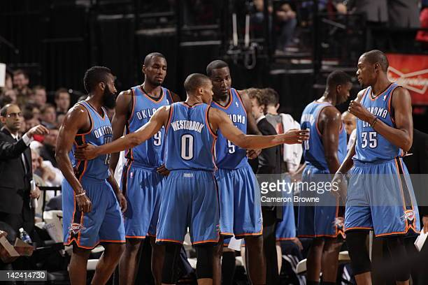 Russell Westbrook gathers Kevin Durant Kendrick Perkins Serge Ibaka and James Harden of the Oklahoma City Thunder to huddle up against the Portland...