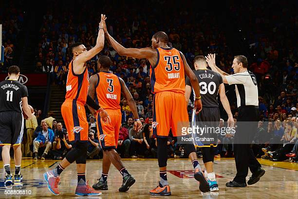 Russell Westbrook high fives teammate Kevin Durant of the Oklahoma City Thunder during the game against the Golden State Warriors on February 6 2016...