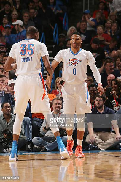 Russell Westbrook high fives teammate Kevin Durant of the Oklahoma City Thunder during the game against the Utah Jazz on March 24 2016 at Chesapeake...