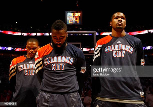 Russell Westbrook James Harden and Kevin Durant of the Oklahoma City Thunder look on prior to Game Four of the 2012 NBA Finals against the Miami Heat...