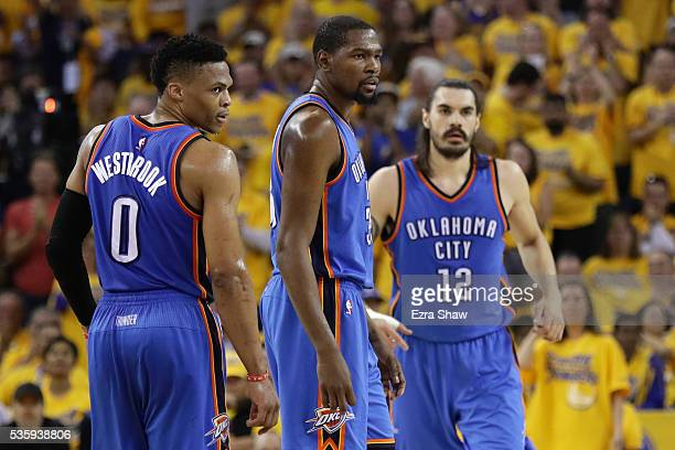 Russell Westbrook Kevin Durant and Steven Adams of the Oklahoma City Thunder stand on the court in Game Seven of the Western Conference Finals...