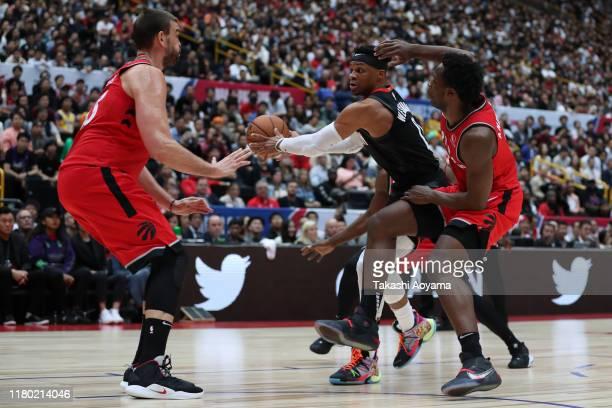 Russell Westbrook of Houston Rockets handles the ball against Toronto Raptors defense during the preseason match between Toronto Raptors and Houston...