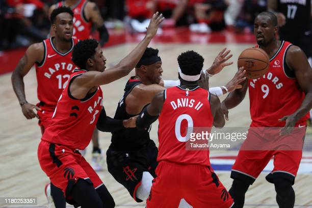 Russell Westbrook of Houston Rockets passes the ball against Toronto Raptors defense during the preseason game between Toronto Raptors and Houston...