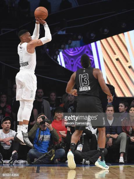 Russell Westbrook of Team LeBron shoots as James Harden of Team Stephen looks on during the NBA AllStar Game 2018 at Staples Center on February 18...