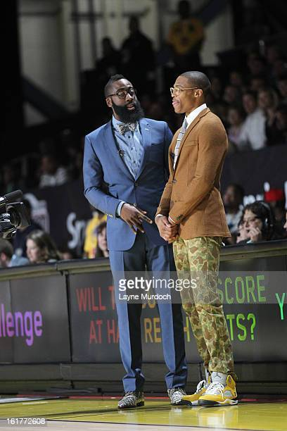 Russell Westbrook of the East team and James Harden of the West team talk during the Sprint Celebrity Game at Jam Session during NBA All Star Weekend...