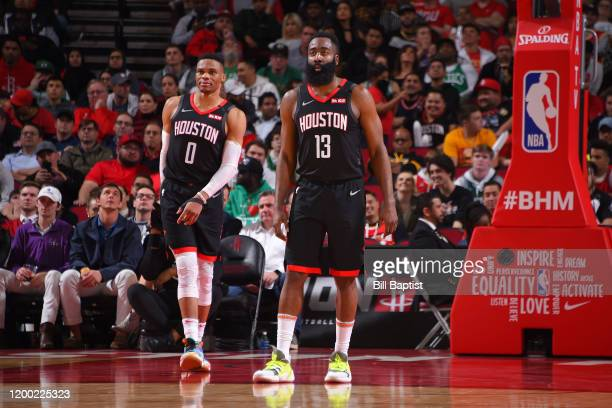 Russell Westbrook of the Houston Rockets and James Harden of the Houston Rockets look on during a game against the Boston Celtics on February 11,...