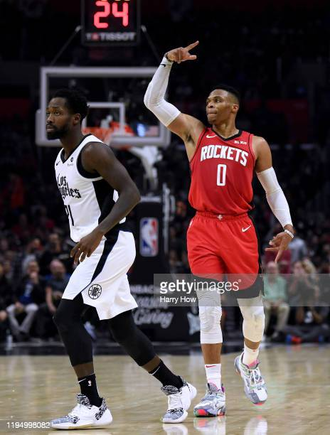 Russell Westbrook of the Houston Rockets celebrates his three pointer behind Patrick Beverley of the LA Clippers to take a 101-89 lead, during the...