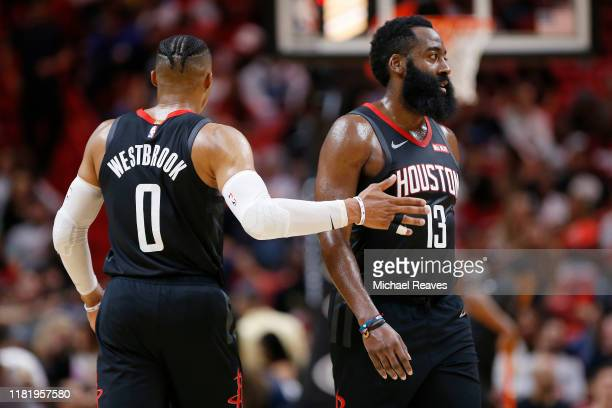 Russell Westbrook of the Houston Rockets celebrates with James Harden against the Miami Heat during the first half at American Airlines Arena on...