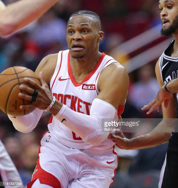 Russell Westbrook of the Houston Rockets drives to the basket against the San Antonio Spurs during the fourth quarter at Toyota Center on October 16...