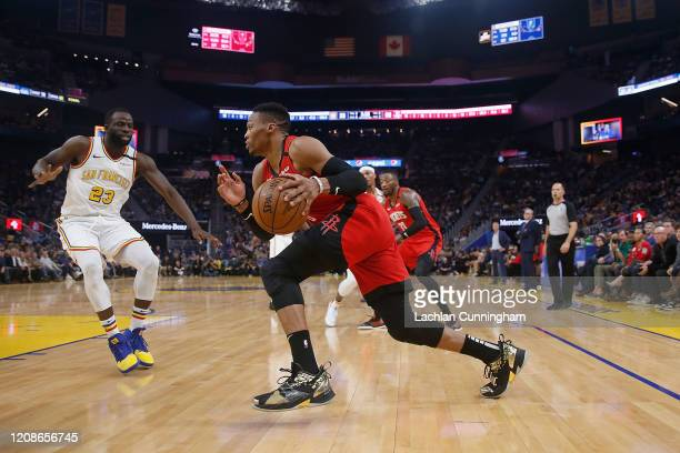 Russell Westbrook of the Houston Rockets drives to the basket against Draymond Green of the Golden State Warriors in the first half at Chase Center...