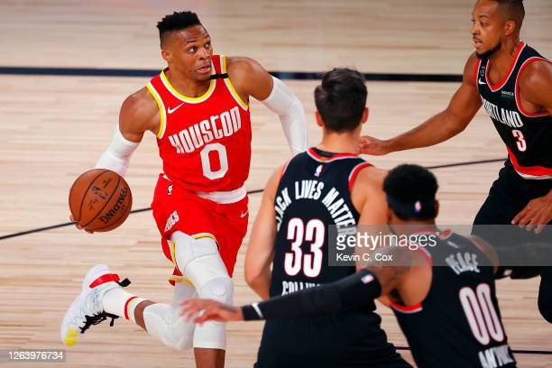 Russell Westbrook of the Houston Rockets drives to the basket against the Portland Trail Blazers during the first half at The Arena at ESPN Wide...