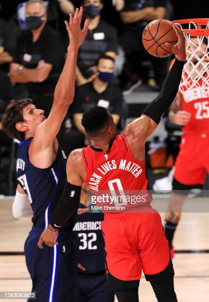 Russell Westbrook of the Houston Rockets drives to the basket during the first half against the Dallas Mavericks at The Arena at ESPN Wide World Of...