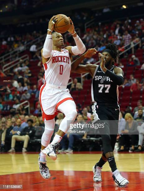Russell Westbrook of the Houston Rockets drives to the basket on DeMarre Carroll of the San Antonio Spurs during the fourth quarter at Toyota Center...