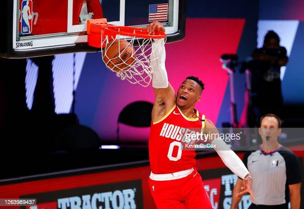 Russell Westbrook of the Houston Rockets dunks the ball during the second half against the Portland Trail Blazers at The Arena at ESPN Wide World Of...