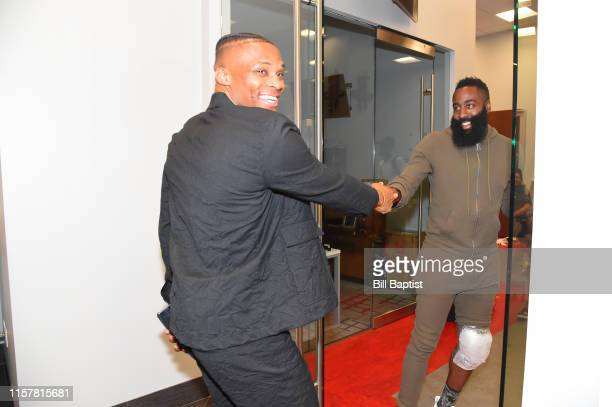 Russell Westbrook of the Houston Rockets gives James Harden of the Houston Rockets Harden a hand shake before the Houston Rockets Introductory Press...