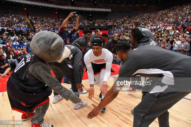 Russell Westbrook of the Houston Rockets hifives team mates before the 2019 NBA Japan Game against the Toronto Raptors on October 10 2019 at Saitama...