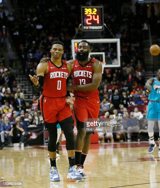 Russell Westbrook of the Houston Rockets is calmed down by James Harden after a technical foul was called on him during the second quarter against...