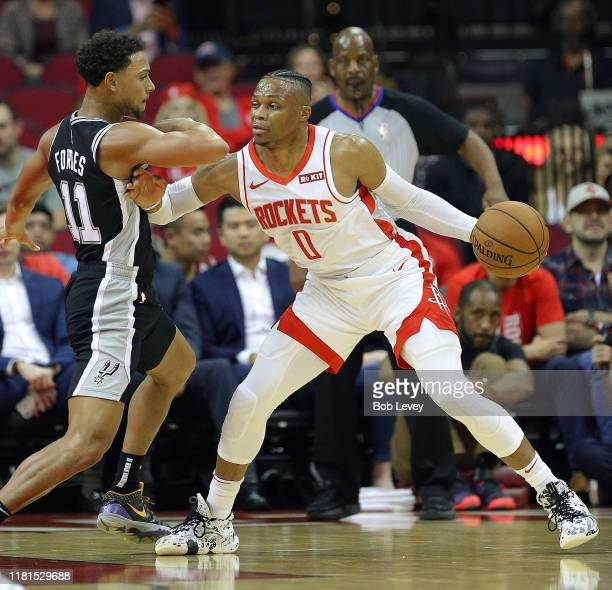 Russell Westbrook of the Houston Rockets is guarded by Bryn Forbes of the San Antonio Spurs as he attempts to drive to the basket during the first...