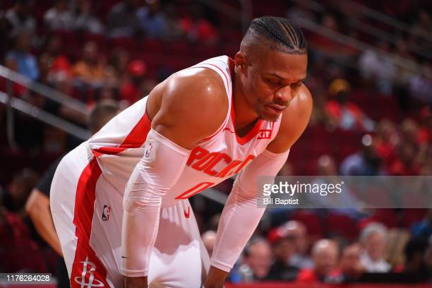 Russell Westbrook of the Houston Rockets looks on against the San Antonio Spurs during a preseason game on October 16 2019 at the Toyota Center in...