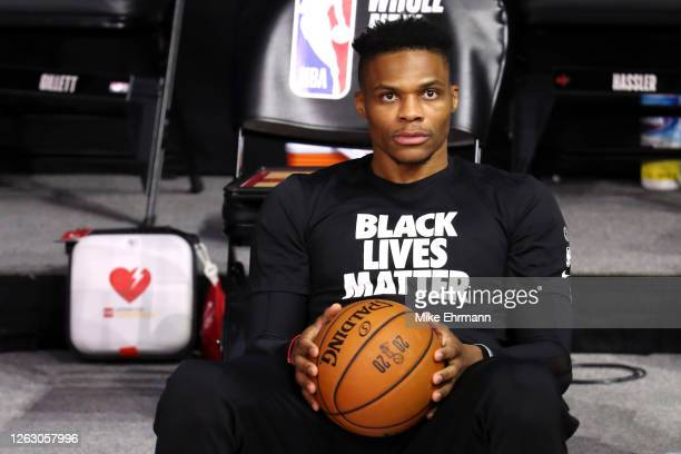 Russell Westbrook of the Houston Rockets looks on before the game against the Dallas Mavericks at The Arena at ESPN Wide World Of Sports Complex on...