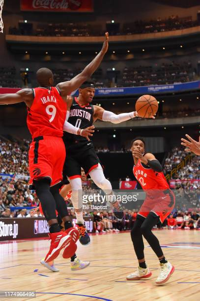 Russell Westbrook of the Houston Rockets passes the ball against the Toronto Raptors during the 2019 NBA Japan Game on October 10 2019 at Saitama...