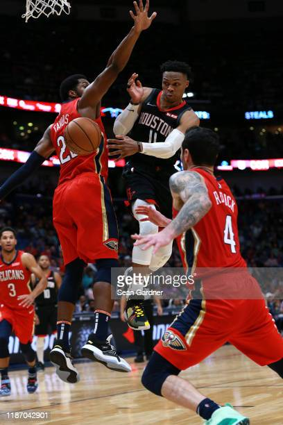 Russell Westbrook of the Houston Rockets passes the ball during a NBA game against the New Orleans Pelicans at the Smoothie King Center on November...