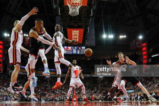 Russell Westbrook of the Houston Rockets passes the ball to Isaiah Hartenstein defended by Bam Adebayo of the Miami Heat in the first half at Toyota...