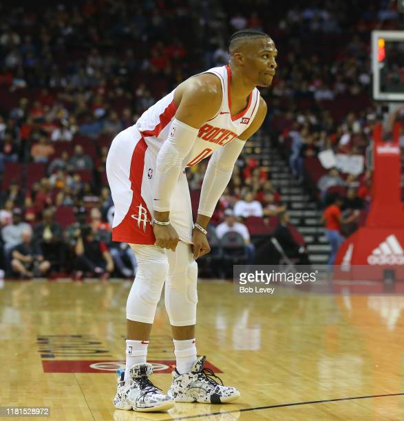 Russell Westbrook of the Houston Rockets pauses druing a break in the action during the first quarter against the San Antonio Spurs at Toyota Center...