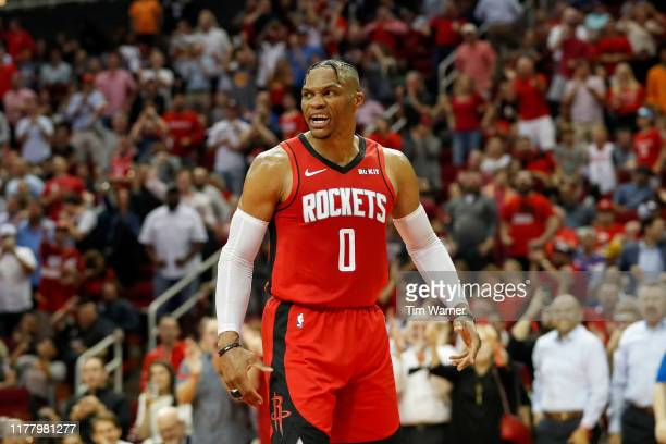 Russell Westbrook of the Houston Rockets reacts after a dunk in the second half against the Milwaukee Bucks at Toyota Center on October 24 2019 in...