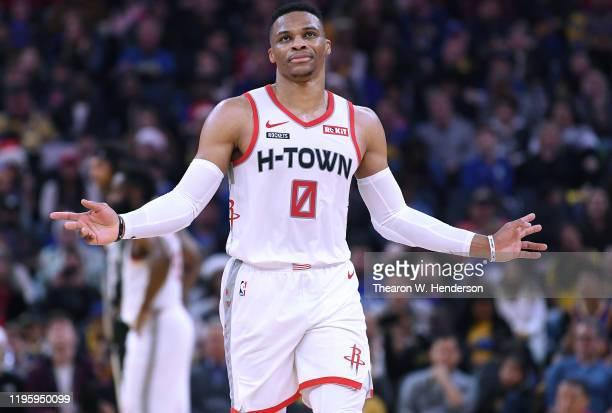Russell Westbrook of the Houston Rockets reacts after he was called for a foul against the Golden State Warriors during the first half of an NBA...