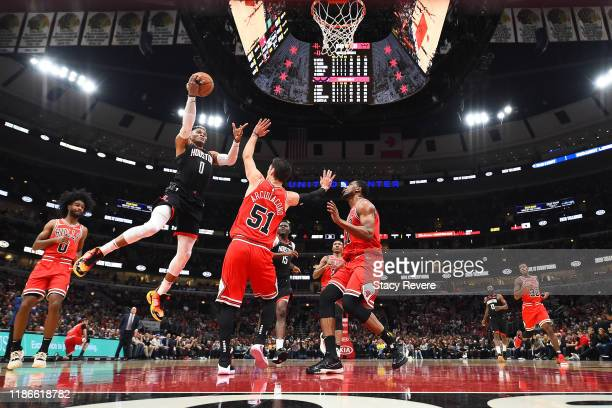 Russell Westbrook of the Houston Rockets shoots over Ryan Arcidiacono of the Chicago Bulls during the first half of a game at United Center on...