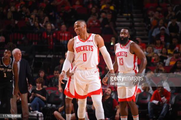 Russell Westbrook of the Houston Rockets smiles against the San Antonio Spurs during a preseason game on October 16 2019 at the Toyota Center in...