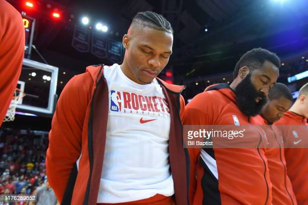 Russell Westbrook of the Houston Rockets stands for the National Anthem prior to a preseason game against the San Antonio Spurs on October 16 2019 at...