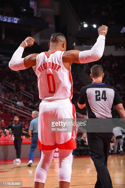Russell Westbrook of the Houston Rockets stretches against the San Antonio Spurs during a preseason game on October 16 2019 at the Toyota Center in...