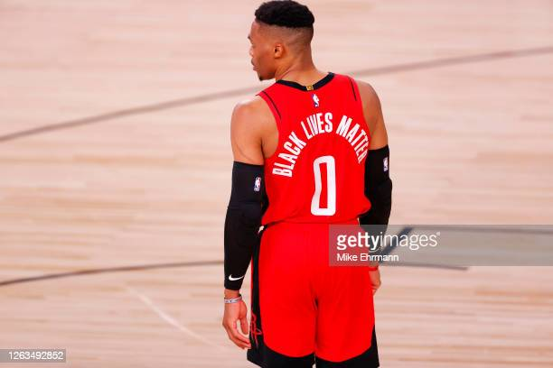 "Russell Westbrook of the Houston Rockets wears ""Black Lives Matter"" on the back of his jersey against the Milwaukee Bucks at The Arena at ESPN Wide..."