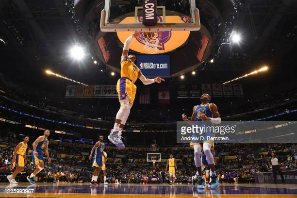 Russell Westbrook of the Los Angeles Lakers dunks the ball against the Golden State Warriors on October 19, 2021 at STAPLES Center in Los Angeles,...